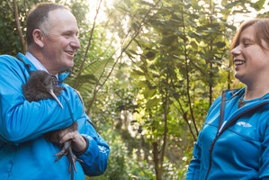 Prime Minister John Key with a kiwi at Rainbow Springs and staff member Emma Bean. Photo/Stephen Parker