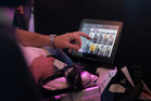 A passenger browses the entertainment selection in Air New Zealand's premium economy. Photo / Nick Reed