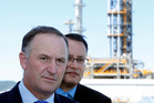 Prime Minister John Key shadowed by Whangarei MP Shane Reti during a visit to the Marsden Point oil refinery.