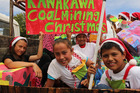 The kids of Kawakawa Primary School celebrate their town's history in a previous Christmas parade. PHOTO / PETER DE GRAAF