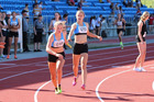 SMOOTH TRANSITION: In one flawless motion Tayla Brunger passes the batton to Sophie Redmayne to win the 4x400 junior girls relay at the NZ Secondary Schools champs in Auckland at the weekend.