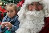 Lolo Kupenga, 3, from Hastings, with Santa, at Santa's Wonderland in Hastings. Photo / Paul Taylor