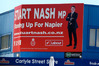 IN LABOUR: A giant billboard fronting a Napier corner store signals Stuart Nash's intention to continue delivering for the people of Napier. PHOTO/WARREN BUCKLAND