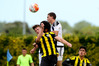 Bay United's Nile Walwyn and Martin Canales Ramos (obscured) put the squeeze on Wellington Phoenix Under-20 defender Dylan Fox at Park Island, Napier, yesterday. PHOTO/Warren Buckland