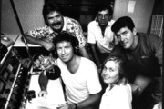 John Hawkesby at the microphone with other Radio Hauraki staff including (clockwise), Phil Gifford, Phil Yule (producer), Kevin Black and Julie Collier. Photo / Herald Archive
