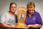 Thomas and Cherry Daly with the historic Mick Griffin Memorial Trophy for chopping. Photo / John Stone