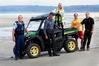 Waipu policeman Martin Geddes, Waipu surf lifesaving club president Rick Stolwerk, Lucy Griffin ambassador, Ruakaka surf lifesaving president Andrew Forsythe and vehicle sponsor Ben Thompson.