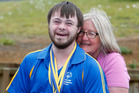 Special Olympics powerlifting champ Josh Cooke with his supportive mother, Sharon. Photo / Michael Cunningham