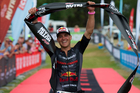 Braden Currie celebrates his breakthrough win at the Kellogg's Ironman 70.3 Taupo last year. PHOTO/SUPPLIED