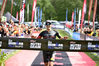 Men's winner Braden Currie crosses over the finish line at the 2016 Kellogg's Nutri-Grain Ironman New Zealand in Taupo today. PHOTO/ DARRYL CAREY