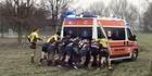 Watch: Watch: Opposing Italian rugby teams push ambulance