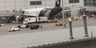 Watch: Watch: Man chased around San Francisco Airport tarmac near Air New Zealand plane