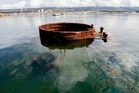 Oil still leaks from the USS Arizona, submerged in the waters. Photo / AP