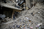 A Syrian girl walks amid the wreckage of buildings in Aleppo. Picture / AP