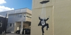 Watch: Banksy pays tribute to PM John Key, or does he?