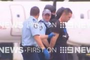 Police pictured during a tense standoff at Sydney Airport. Photo / Nine News