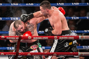 Joseph Parker lands a blow on Andy Ruiz during their WBO world boxing heavyweight title fight. Photosport