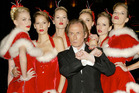 Bill Nighy (center) during Love Actually Premiere in London. Photo / Getty