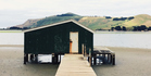 A boat house at low tide on the Otago Peninsula. Photo / NZ Herald