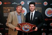 Martin Snedden and Craig Stanaway unveil the WBO world boxing organisation heavyweight belt. Photo / Photosport