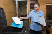 Prime Minister of New Zealand John Key cleans out his office on the 9th floor of the Beehive in Wellington. Photo / Marty Melville