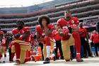 2016 AP YEAR END PHOTOS - San Francisco 49ers outside linebacker Eli Harold, left, quarterback Colin Kaepernick, center, and safety Eric Reid kneel during the national anthem. Photo / AP.