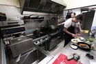 Chef Phil Clark prepares a pork fillet in his Kingsland restaurant 'Phil's Kitchen'.