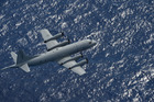A RNZAF Orion P-3K2 is expected to reach the search area off Kiribati around 2.30pm today to help search for three fishermen. Photo / Supplied