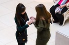 Jessica Rodriguez proposed to her partner Chelsea Miller at the Art Institute of Chicago. Photo / @AreYouShook Twitter