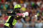 Andre Russell of the Thunder using in black and pink bat during the Big Bash season opener. Photo / Getty