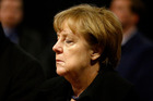 German Chancellor Angela Merkel arrives to sign the condolence book at the Memorial Church in Berlin, Germany. Photo / AP