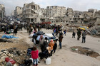 People queue to evacuate Aleppo. Photo / Getty Images
