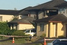 Neighbours have told of hearing screaming and glass breaking in a house fire that killed three people in South Auckland. Photo / Catherine Gaffaney