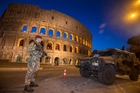 Italy has been strengthening security measures in areas where crowds are   expected to gather such as the Colosseum in Rome. Picture / AP