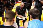 Breakers coach Paul Henare speaks to his team during their loss in Sydney. Photo / Getty