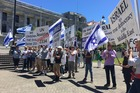 Protesters gather outside Parliament in support of Israel following the adoption of the UN Resolution 2334. Photo/Melissa Nightingale