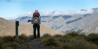 VISTA: Tauranga tramper Joanne Bruce crests a ridge on Shania Twain's Motatapu Alpine Track, which forms part of New Zealand's 3000km Te Araroa trail. Photo / Scott K MacLeod