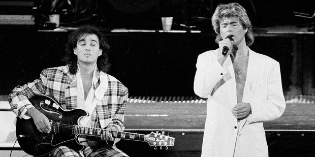 George Michael and Andrew Ridgeley of the British group WHAM! perform during a concert in Peking, China. Photo / AP