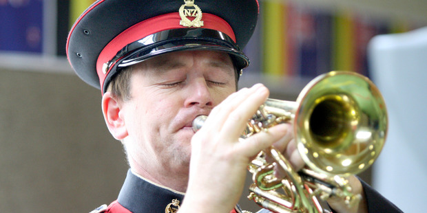 Graham Hickman playing the last post. Photo / Christchurch Star