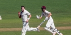 DEFIANCE: CD bowler Bevan Small waits for a fielder to rifle the ball to the stumps as ND century maker Tim Seifert scoots past in Napier. PHOTO/Paul Taylor