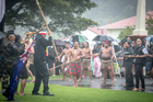 The hikoi from the anti-TPP protest in Auckland is welcomed back onto Te Tii Marae. Photo / Michael Craig