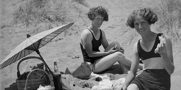 Ladies in swimwear on the beach, circa 1920s. Photo / Te Papa Collection