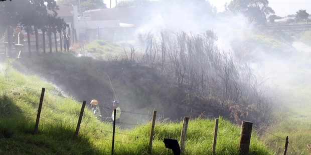 SOME HOLIDAY: Kaitaia firefighters dousing one of numerous grass fires that were reported on Monday, when everyone else was having a day off.