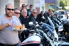DIG IN: Triumph motorcycle riders look on as Peter (Clarkey) Clarke goes for a bit of the Grand Hotel's apple pie.PHOTO/BEVAN CONLEY