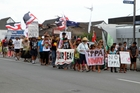 Around 100 people marched through Kaitaia yesterday as the anti-TPP hikoi heading to Waitangi hit the town. Photo / Peter Jackson