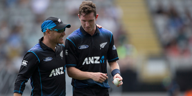 Brendon McCullum congratulates Adam Milne after his wicket. Photo / Greg Bowker