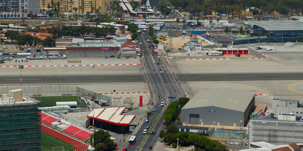 The runway at Gibraltar Airport intersects with a busy road. Photo / 123RF