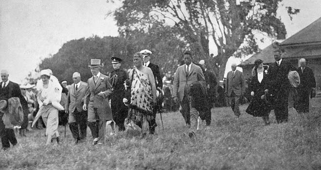 Northern Maori Member of Parliament Taurekareka Hanare escorts Governor-General Lord Bledisloe and his wife onto the land where the Treaty of Waitangi had been signed 94 years earlier. (Te Ara)