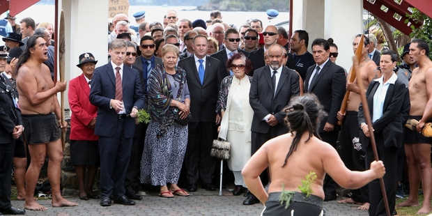 Prime Minister John Key is escorted on to Te Tii marae ahead of last year's Waitangi Day celebrations by Titewhai Harawira. This year he may not be welcomed on after a hui of Ngapuhi voted to ban him from the marae. Photo / John Stone