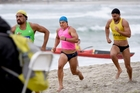 Taris Harker (centre) digs in along the beach for Bay of Plenty during Monday's New Zealand Representative Challenges at Mount Maunganui. Photo / George Novak